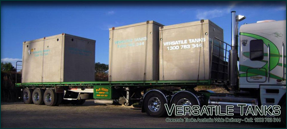 Versatile concrete Tanks being delivered by truck